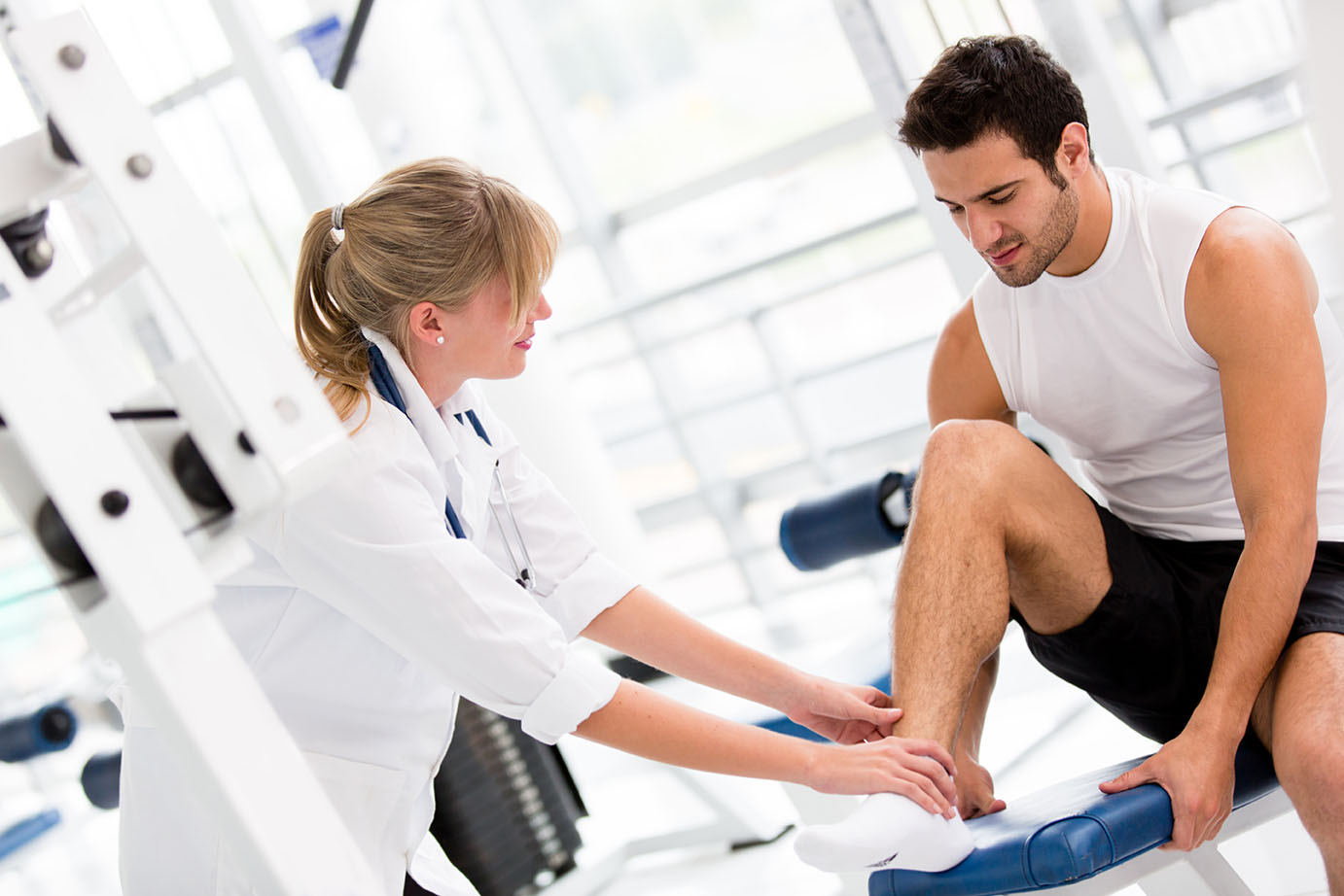 male-getting-ankle-examined